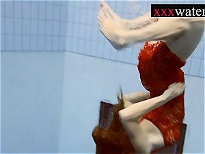 beautiful super hot gal swimming in the pool
